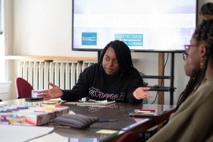 Zaniya Lewis works with high school students at the School Without Walls